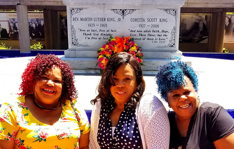 Three women in front of MLK Jr. gravestone