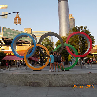 Girls posing in front of Olympic Rings