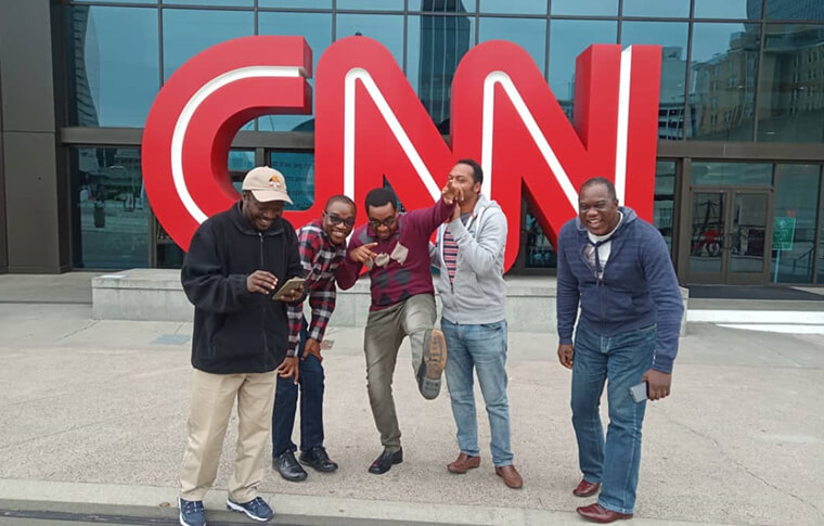 Group of men outside of CNN building