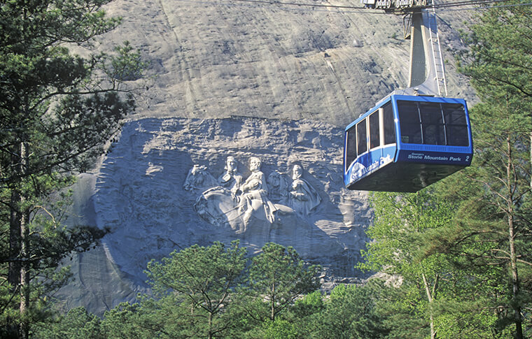 Cable car in front of confederate carving