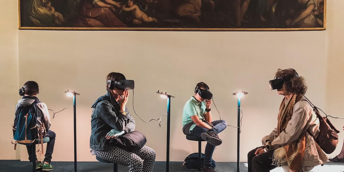 people using virtual reality headsets in a museum