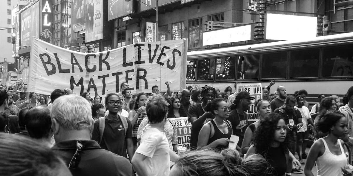 protesters holding sign saying black lives matter