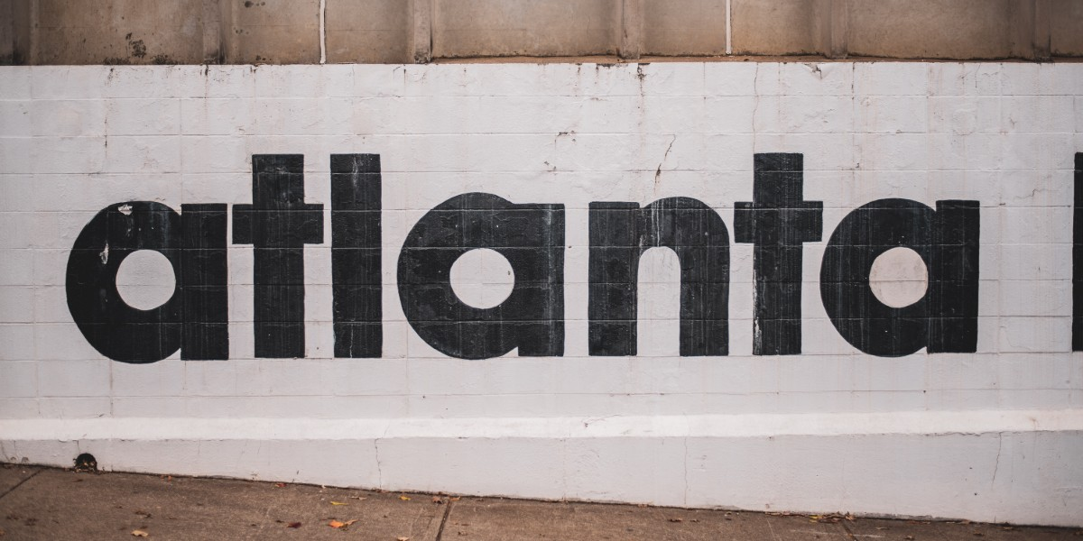wall with atlanta painted on in black